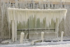 Frozen breakwater and bus stop after winter storm Royalty Free Stock Photo