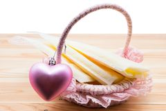 Frozen breast milk on basket  on white. Frozen breast milk in storage bags in basket with pink heart on wood  on white background. Nutrition food for baby Stock Images