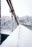 Frozen bridge. In park in winter Stock Image