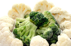 Frozen broccoli and cauliflower. Healthy variety of vegetable pieces mixed together Royalty Free Stock Images