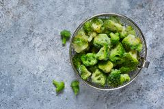 Frozen broccoli on a concrete background with space for text, healthy diet food. View from above royalty free stock photography