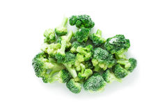 Frozen broccoli. Heap of fresh frozen broccoli  over white, top view Royalty Free Stock Image