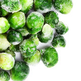 Frozen Brussels sprouts cabbage isolated on white background top Stock Photos