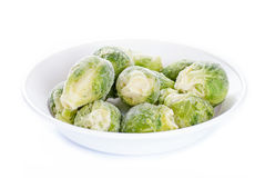 Frozen brussels sprouts on white Royalty Free Stock Photos