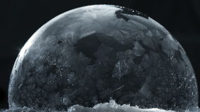 Frozen bubble with flying snowflakes, winter holidays background, stock footage
