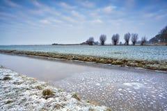 Frozen canal in dutch farmland Stock Image