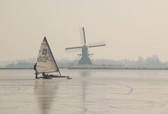 Frozen Canals in Holland. Dutch Winter Landscape. Ice skaters in a Dutch Winter in a landscape with windmills Royalty Free Stock Image