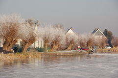 Frozen Canals in Holland. Dutch Winter Landscape. Ice skaters in a Dutch Winter in a landscape with windmills Stock Photography