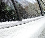 Frozen car covered with snow and ice in winter. melting ice on t royalty free stock image