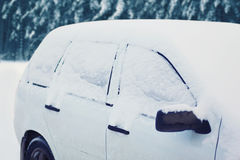 Frozen car covered snow in winter day Royalty Free Stock Photography
