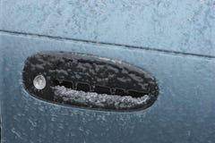 Frozen car door lock due to freezing rain stock images