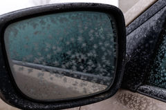 Frozen car mirror closeup differ large snowflakes. Frozen car mirror closeup. Differ large snowflakes. Hoarfrost on the mirror machine Royalty Free Stock Photography