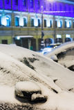 Frozen car during night snowfall Royalty Free Stock Images