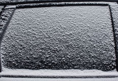 Frozen car side window snow, texture freezing ice glass background Stock Photos
