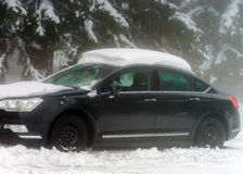 Frozen car with snow hat Stock Photography