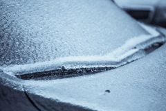 Frozen car wind screen with wipers stock photo