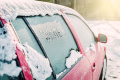 Frozen car window, car parked outside, winter transport Stock Photos