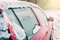 Frozen car window, car parked outside, winter transport Stock Photos
