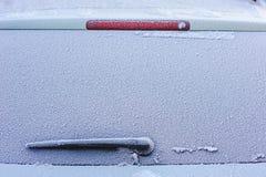 Frozen car window. Frozen rear window of the car with windshield wiper Royalty Free Stock Image