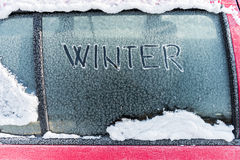 Frozen car window, winter transport issues Royalty Free Stock Images