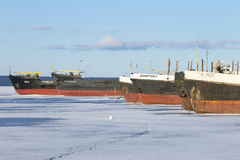 Frozen cargo ships in the port on Onega lake at winter time Stock Image
