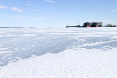 Frozen cargo ships in the port at winter time Royalty Free Stock Photos