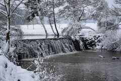 Frozen Cascade in French Countryside during Christmas Season / Winter stock image