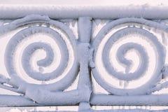 Frozen cast iron fence Stock Image