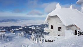 Frozen Chalet in Charpatians Montains