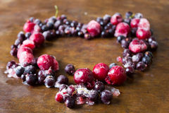 Frozen cherries and black currant on ice stock photo
