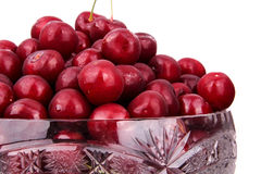 Frozen cherries in a bowl. isolated on white background Stock Images