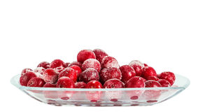 Frozen cherries on a plate on white background Royalty Free Stock Photos