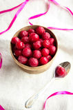 Frozen cherries in a wooden bowl Stock Photography
