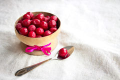 Frozen cherries in a wooden bowl Royalty Free Stock Photography