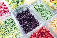 Free Frozen Cherry Berries. Freezing Vegetables And Fruits. Food Products Are Poured Into Rectangular Plastic Trays. Royalty Free Stock Image - 170892226