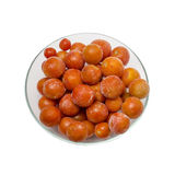 Frozen cherry tomatoes. Isolated on white background Royalty Free Stock Photos