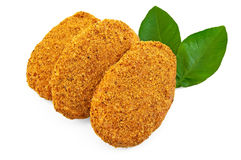 Frozen chicken cutlets with leaves Royalty Free Stock Photo