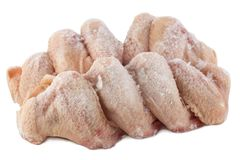 Frozen chicken wings. White background, isolated. Cold,poultry meat stock photography