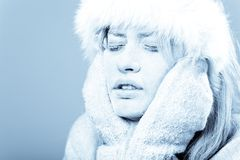 Frozen. Chilled female face covered in ice. Royalty Free Stock Photos