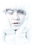 Frozen. Chilled female face covered in ice. Frozen. Close-up portrait of chilled female face covered in ice stock image