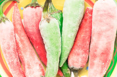 Frozen chilli peppers Stock Photography