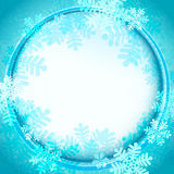 Frozen circle frame covered by blue snowflakes vector Stock Photos