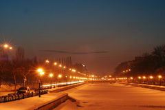 Frozen city river. In a winter night Royalty Free Stock Images