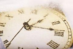 Frozen clock. A antic  clock frozen in ice Stock Images