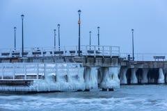 Frozen coast of Baltic Sea in Gdansk. Frozen pier at Baltic Sea in Gdansk, Poland Royalty Free Stock Photos