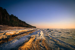 Frozen coast of the Baltic Sea. At sunset in Lithuania Stock Photography