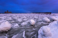 Frozen coastline of Baltic Sea in Gdynia. At dusk, Poland Stock Image