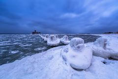 Frozen coastline of Baltic Sea in Gdynia. At dusk, Poland Royalty Free Stock Image