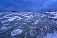 Frozen coastline of Baltic Sea in Gdynia. At dusk, Poland Stock Images