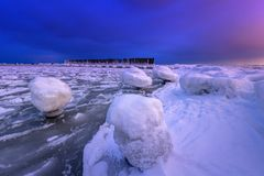 Frozen coastline of Baltic Sea in Gdynia at night. Frozen coastline of Baltic Sea in Gdynia at dusk, Poland Royalty Free Stock Images
